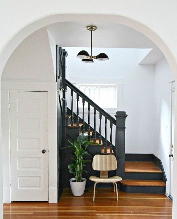 Love the charcoal grey color of the stairs against the white walls and the warm color of the wood floor