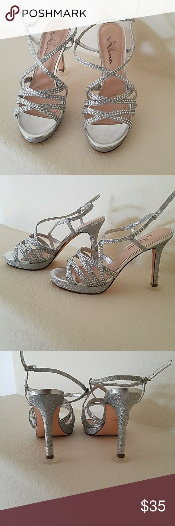 Sparkly Silver Heels Only worn once Heel stoppers are on, but I can take them off if you do not want them.  Used for bridesmaid shoes Perfect condition Touch of Nina Shoes Heels