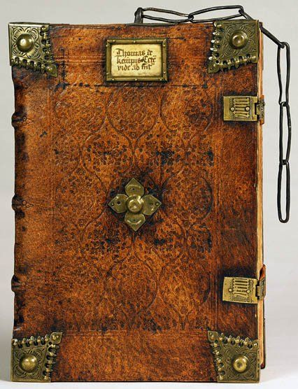 "Thomas à Kempis (1379/1380–1471). Opera. Nuremberg, 1494. With St. Albertus Magnus. Compendium theologice veritatis. Strasbourg, 1489. Folger Shakespeare Library. ""Bound in a German chained binding, c. 1495, of alum tawed pigskin over wooden boards with blind decoration and adorned with brass corner bosses, title plaque, clasps, and several links of iron chain... Upper cover decorated... with tendrils; lower cover central panel divided in 12 lozenges with a fleur-de-lys stamped in the…"