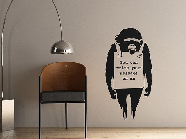 Featuring a monkey holding a sign that can be personalised with your own message! This wall sticker is infuenced by the original design by Banksy.