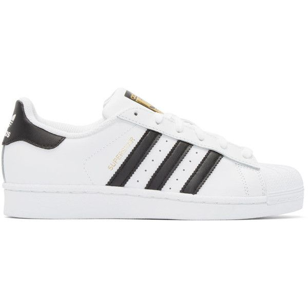 adidas Originals White and Black Superstar Sneakers ($75) ❤ liked on Polyvore featuring shoes, sneakers, white black, striped sneakers, lacing sneakers, low profile sneakers, low top and rubber sole shoes