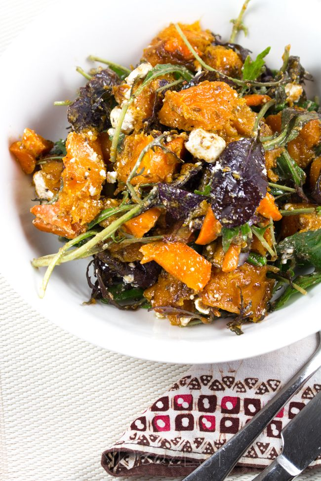 Crunchy Pumpkin Salad - Vibrant cumin roasted pumpkin chunks, crumbles of creamy feta, carrot, mixed lettuce leaves and a sweet balsamic dressing! Healthy and AMAZING!!
