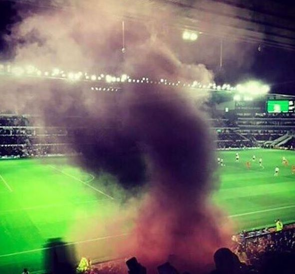 liverbird in smoke at the liverpool fc game