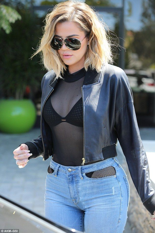 Khloe Kardashian shows off fishnet-clad physique  in unusual jeans #dailymail