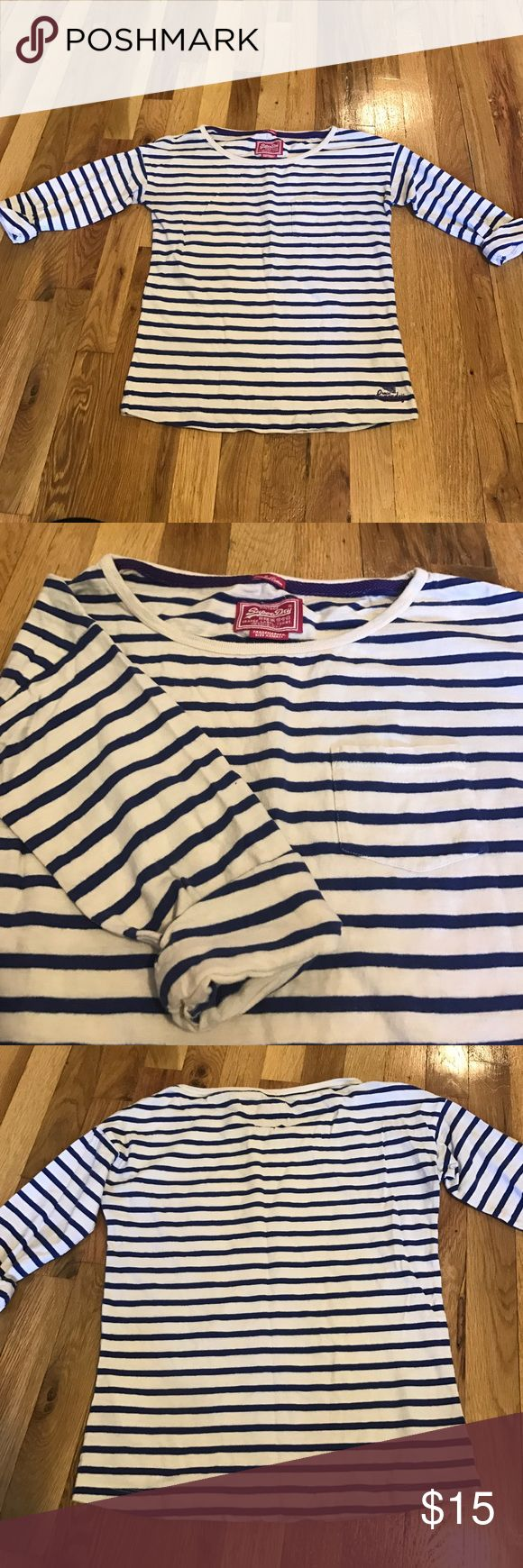SUPERDRY 3/4 Sleeve Women's Striped Tee Navy/White Superdry HIGH QUALITY Striped Tee in Navy/White (almost beige). Half to 3/4 sleeve with built-in roll-up. Front pocket. Combed cotton. Women's US XS - *LIKE NEW!* Superdry Tops Tees - Long Sleeve
