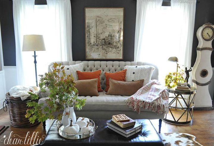 Beautiful fall living room - love the dark gray walls and neutral furniture with a pop of orange. Even with dark gray walls, the room isn't dark.