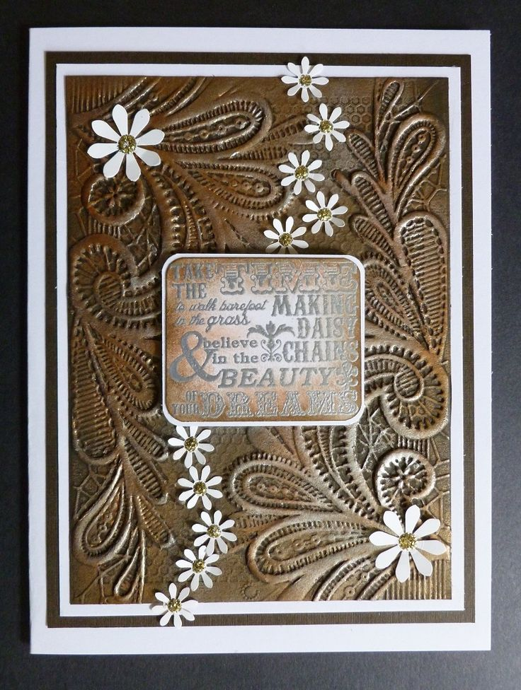 'Daisy Chains' card - Imagination Craft's-Bronze & Silver Alchemy Waxes.  Versamark pad.  Silver embossing powder.  Crafter's Companion embossing folder.   Distress inks-Walnut stain & Black soot.  Sentiment stamp-Indigo Blu.  Gold Stickles Glitter glue.  Daisy punch-Woodware.  Large daisy punch-Carl.  Corner rounder punch.   June 2017.   Designed by Jennifer Johnston.