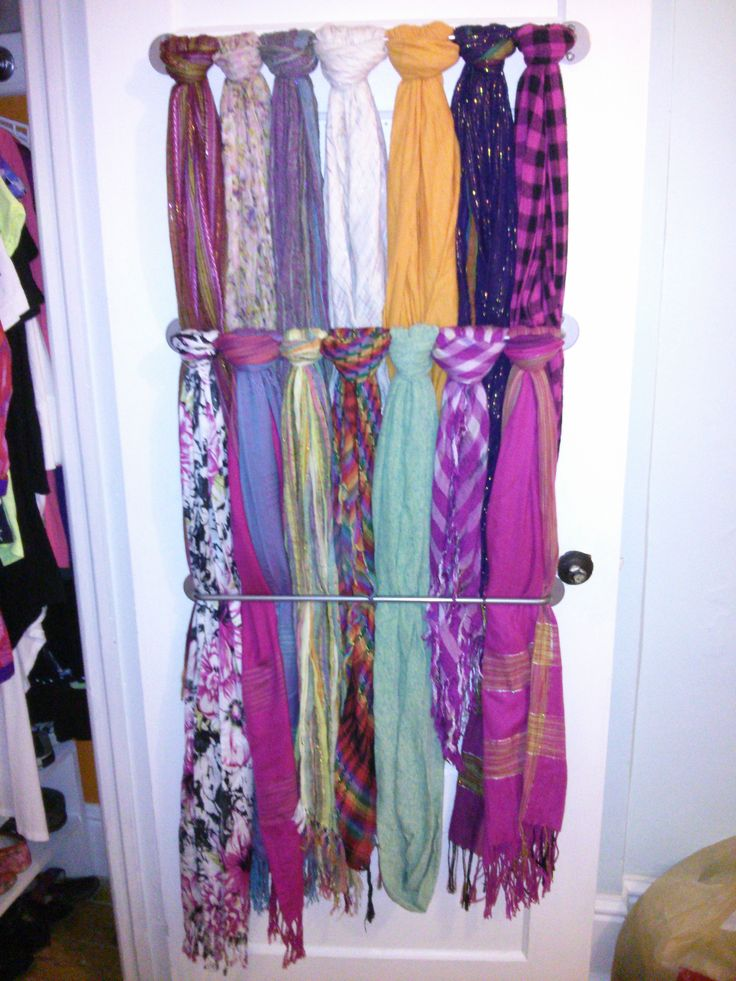 AWESOME & easy scarf storage I made in my closet. all you need is to screw the BYGEL rail (from IKEA) to the inside of  your door (as many as you'd like) & then loop the scarves on to your preference. makes for a clean/artsy look & definitely clutter-free!!    www.ikea.com/ca/en/catalog/products/50072645/