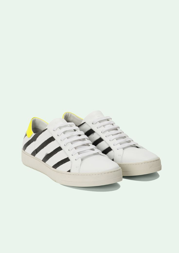 Low-top buffed leather sneakers in white. Round toe. Tonal lace-up closure. Logo embossed at tongue, fluo yellow heel tab.