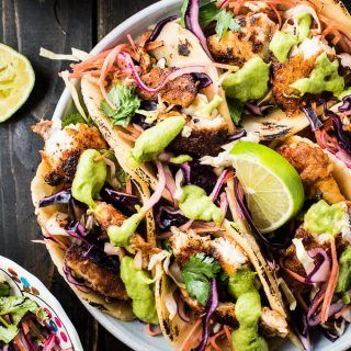 These crazy delicious Baja Fish Tacos are made with white fish coated in blackening spice rub then pan-seared till tender. They're served with a crunchy and easy to make coleslaw and aji guacamole, my all-time favorite taco sauce. They're a healthy dinner recipe that is gluten-free and (if served with lettuce wraps rather than tortillas) paleo + Whole30 approved, too. Dig in! | theendlessmeal.com