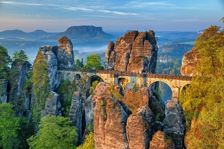 The Bastei is a rock formation towering above the Elbe River in the Elbe Sandstone Mountains of Germany. The Bastei has been a tourist attraction for over 200 years. The bridge was constructed to link several rocks for the visitors