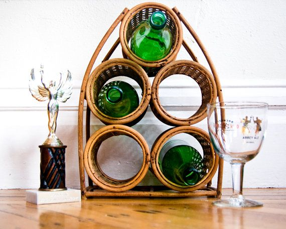 This rattan wine rack has some tropical notes. #sfetsy #rattandecor #vintagewinerack