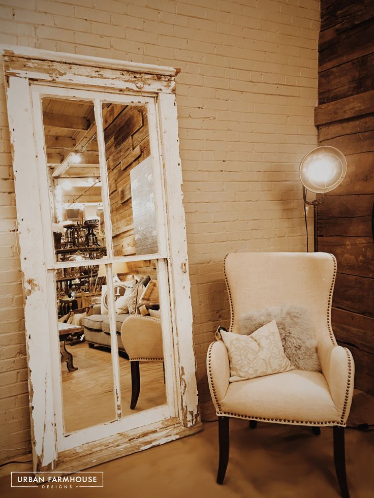 Turn an old window into a show stopping mirror by taking out the panes and replacing with mirrored glass! Visit urbanfarmhouse.com for more farmhouse furniture and inspiration.