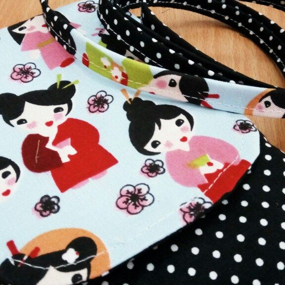 When you buy handmade, you will get one of a kind product. Just like this phone pouch with matching cute strap