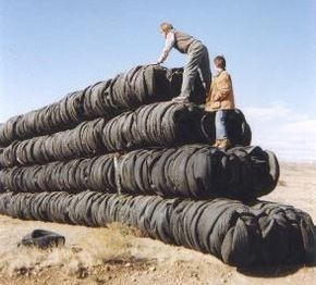 Earthship Technology ~ Tire Bales are usually free if you can haul them & make for really thick walls ;)