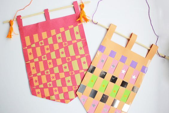 Wool weaving hangings are all the rage at the moment but weaving doesn't just have to be wool, paper weaving works just as well and is easy for little hands to master. Snip snip!