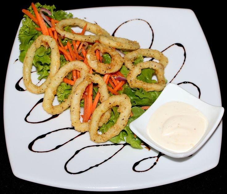 Tomi's Salt and Pepper Calamari - deep fried Calamari served on a small salad with aioli.