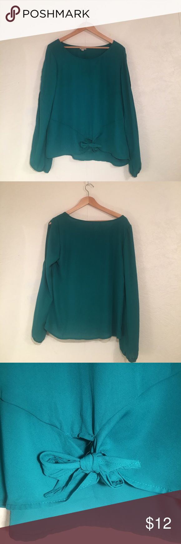 Beautiful Teal Blouse Vibrant teal blouse. Only worn once and in great condition. Features a little knot on the bottom front that can be untied and retied and a divided slit on the arms to show off a little skin. Great for casual or formal occasions! Eyeshadow Tops Blouses