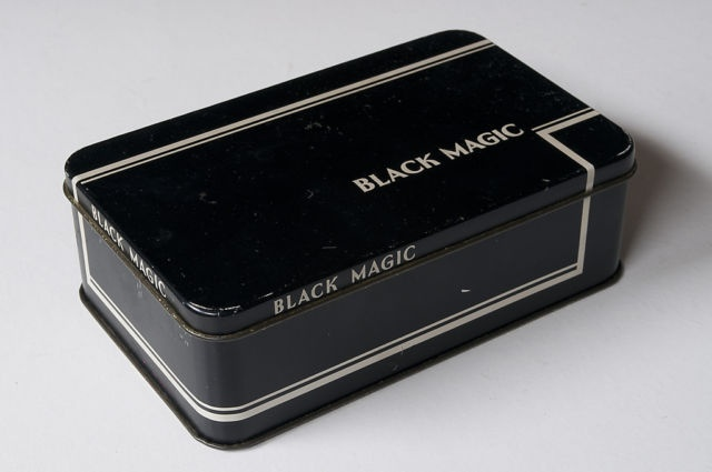 In Kenya these chocolates always came in tins, perfect for storing small collections, scraps, petty foil wrappers, stamps etc. Later they were taken to school as geometry instrument boxes and decorated with intricate pattern by means of a compass point! (Vintage Black Magic Chocolates ½lb tin | eBay)