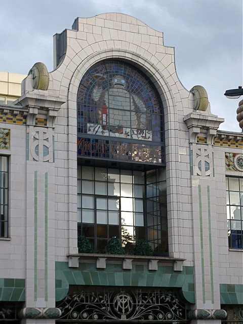 """Michelin House London. This is a former Michelin garage built before WWI in a transition style from Art Nouveau to Art Deco. The architect was a former French employee of the tyre company Michelin.  The building has been successfully converted to the use of a fish gourmet restaurant / bar """"Bibendum"""", a small flower and fish market and a Conran shop."""
