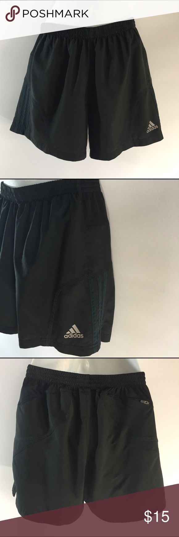 "Adidas response climalite 5"" shorts black lined Adidas response climalite shorts.  Size medium. 100% polyester. In very good preowned condition black with dark teal stripes at sides. Back zippered side pocket at top right lined inside with an elastic waist and inside drawstring. Measurements are 5 inch inseam 14 inches across the waist which stretches to about 20 inches and an 11 inch front rise. adidas Shorts Athletic"