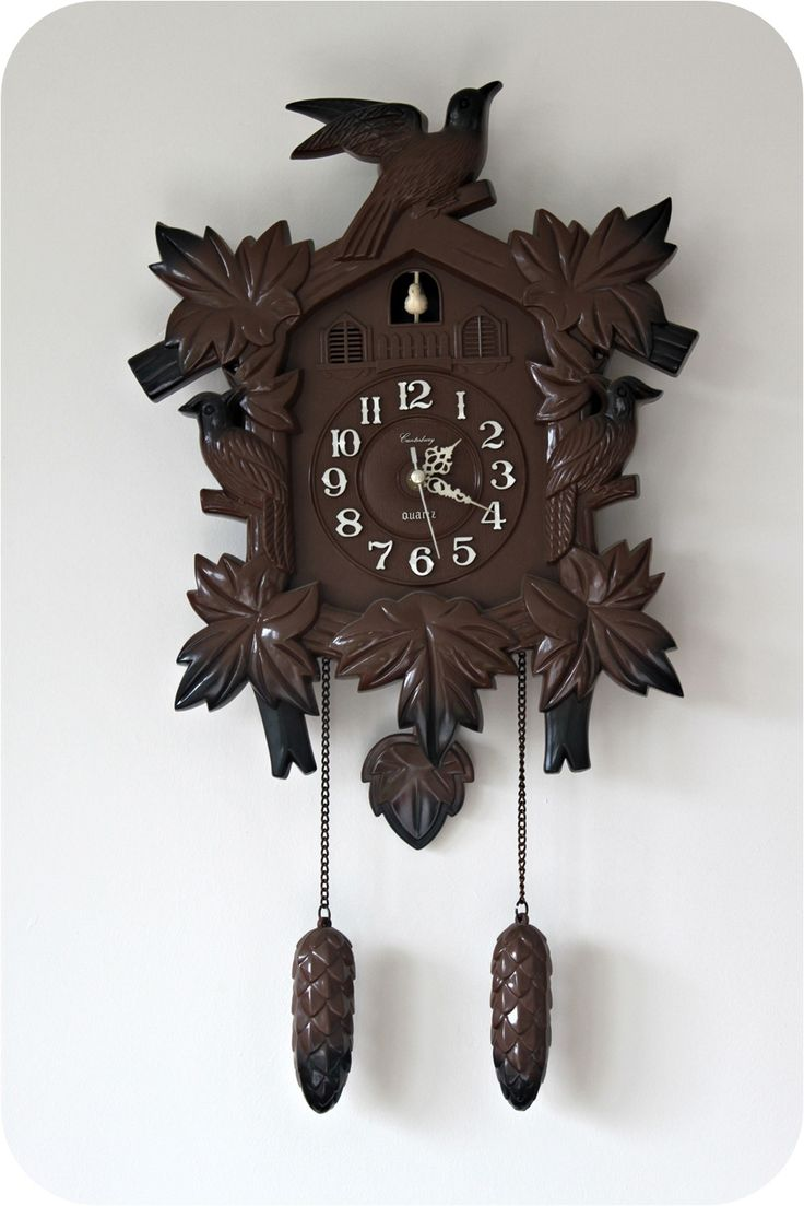 Vintage Cuckoo Clock.  When we were kids my Dad got one.  I loved that little bird coming out each time.