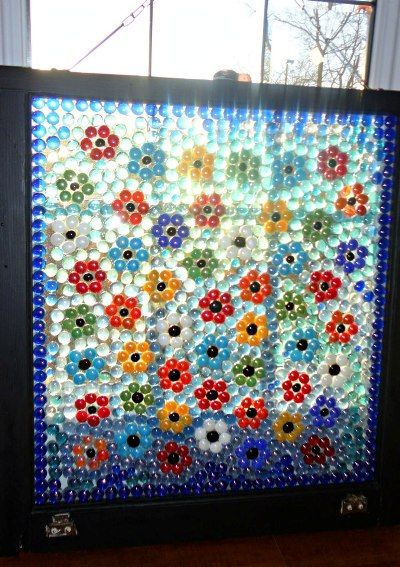 Linda Gladman's peaceful picture--She used flat glass beads/baubles from the dollar store but the flower beads were from Michaels.  Glue was Clear GE II Outdoor Silicone ""