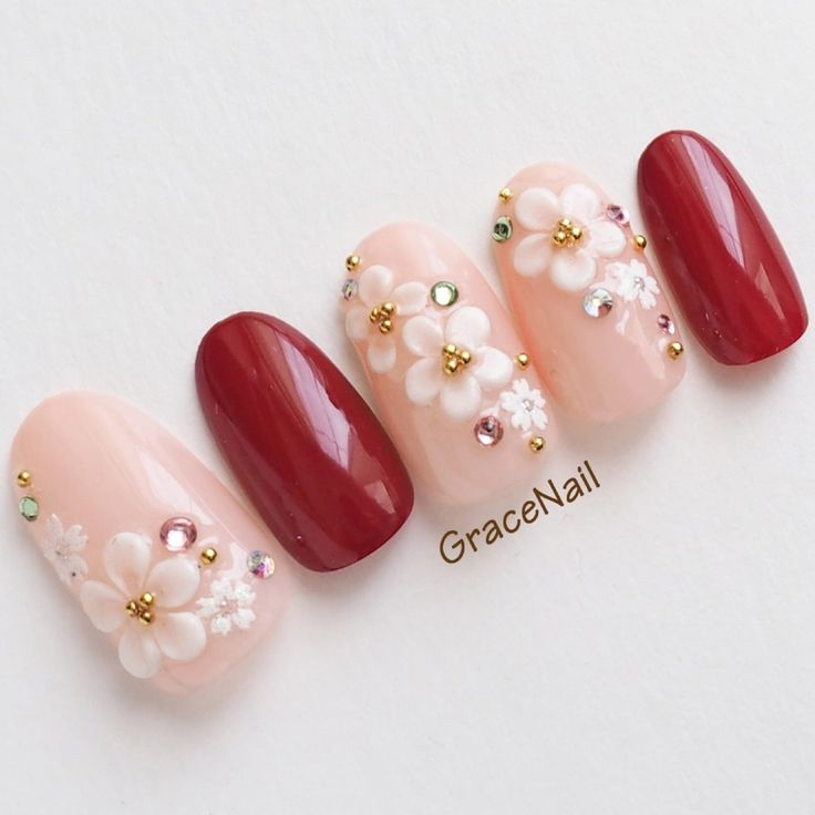 pinks and red cherry blossoms nail art