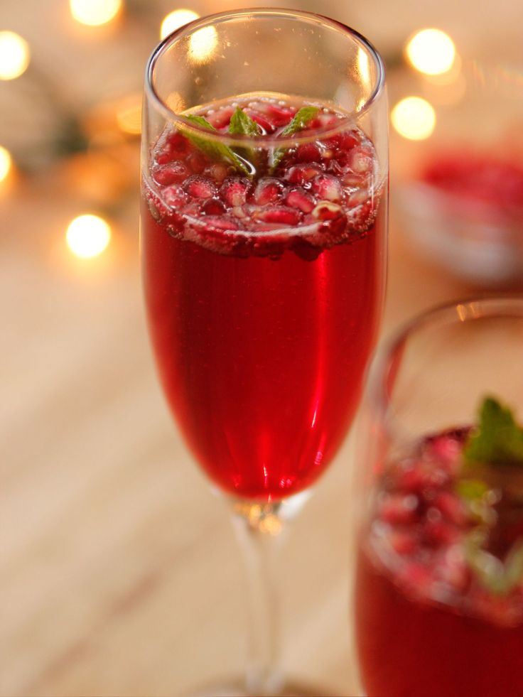 Get this all-star, easy-to-follow Pomegranate Champagne Cocktail recipe from Ree Drummond