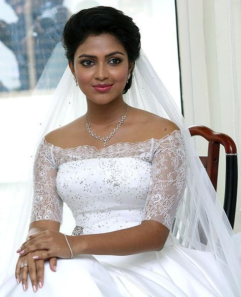 Amala Paul wore a white gown created by designer Anita Dongre. A diamond neckpiece completed the look.