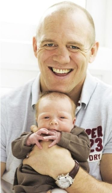 Ex-rugby star Mike Tindall with newborn daughter Mia Hello Magazine Feb. 24, 2014. Mia is the 4th great-grandchild of Queen Elizabeth.