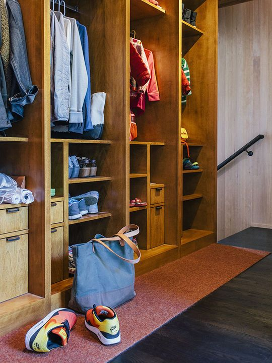 Each member of this Portland family has their own birch cubby for storing outerwear—plus a built-in charging station for keeping digital devices juiced.   Photo by Grant Harder.   This originally appeared in Midcentury Renovation in Portland Capitalizes on Nature with Seven Doors to the Outside.