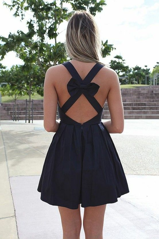 Bow back.. This is a cute dress it would be cuter in