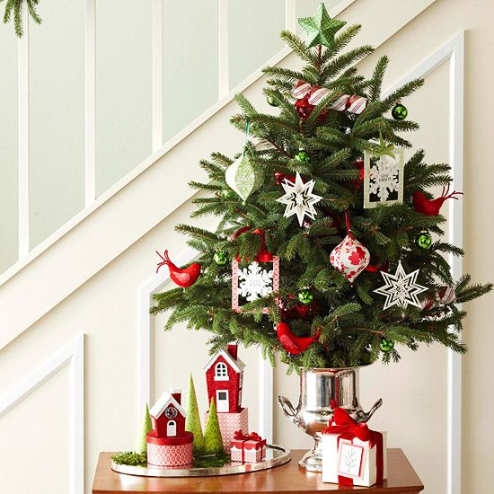 Use Space by the Stairs : A small table by the stairs is a prominent small-space spot to start your Christmas merriment. Add a little, lightly decorated tree and a modest display to the tabletop. To give the evergreen a bit of height, place in a tall silver vase.