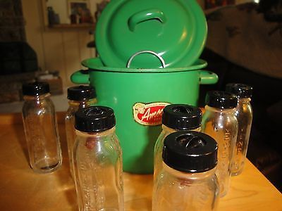 A complete set of glass baby bottles with nipples and caps, pot for sterilizing and the  metal rack. on my ebay site now 7-28-14. bid is around $10 please have a look if you are interested this is a great deal. Vintage Amsco Toy Green Enamel Sterilizer & Rack w/ 7 Evenflo Glass  Bottles.