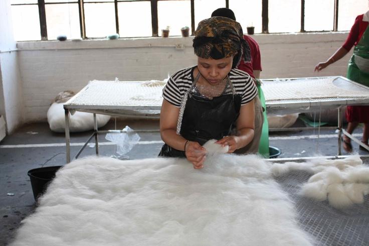 One of the ladies at Ronel Jordaan busy preparing the wool. See amagugu.com