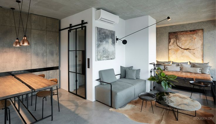 This cool apartment is filled with dark wood and brown leather.