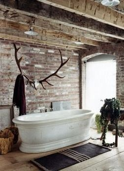 Antlers Bathtub Rustic bathroom Outside inside Rafters Large window