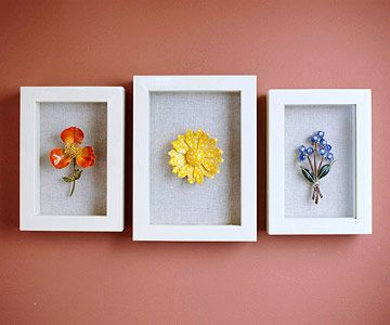 Enameled flower pins discovered at a flea market make a simple and graphic design statement when grouped into a triptych of shadow-box frames. Similar treatments of other like items, such as cloisonne or cameo pendants, could be equally interesting.