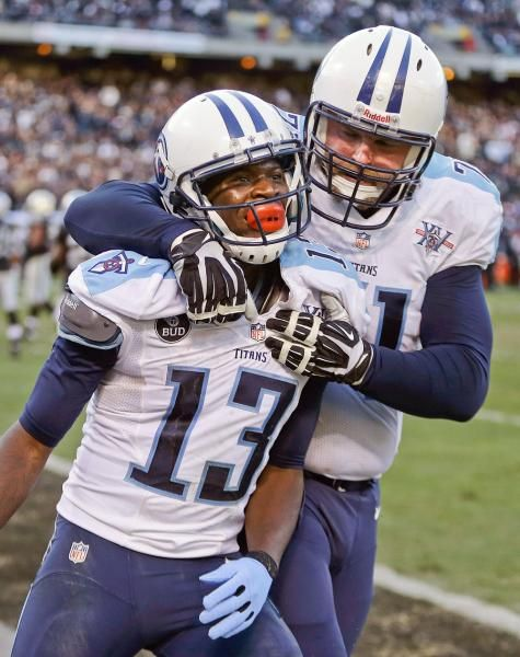 a1ef1a4da Tennessee Titans WR Kendall Wright (13) celebrates with LT Michael Roos  (71) ...