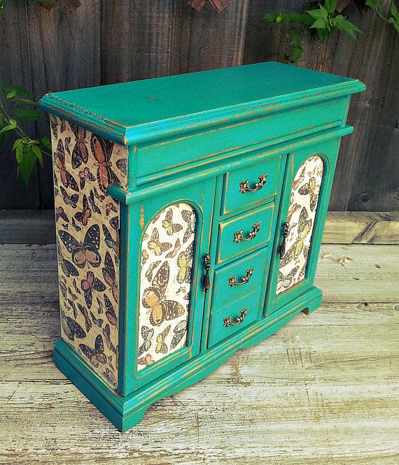 jewellery armoire, butterfly jewellery box, vintage jewelry box, jewelry drawers, shabby chic jewelry box, up cycled jewellery box, turquoise jewelry box  Dimensions approx : 31(h) x 34 x 12,5 cm.  This gorgeous vintage jewellery armoire/cabinet has been revitalised by hand-painting with turquoise chalk paint, gently distressed. I used high quality paper to decorate the cabinet. The whole cabinet was waxed with satin wax. It can be wiped with a damp cloth. There are 5 sections in the top...