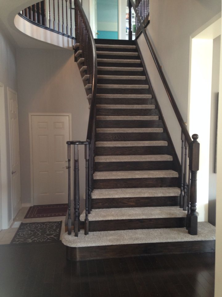 Beautiful staircase by Floors in Motion in Brooklin. Multi-colour plush carpet was installed on the treads of the stairs, leaving the risers hardwood. This allows you to have the look of hardwood stairs, with the comfort and slip resistance of carpet... This also prevents the need of using a big ol' runner.  Www.floorsinmotion.com