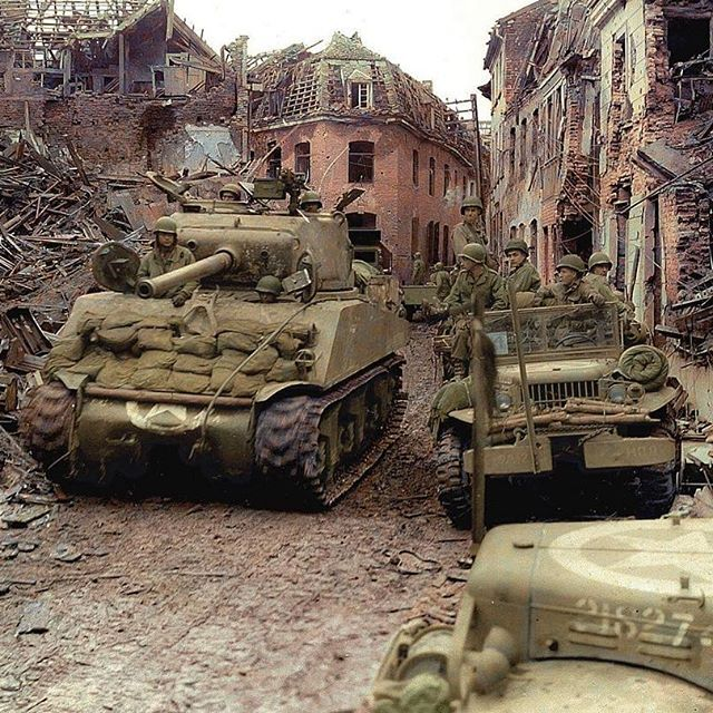 """the_ww2_memoirs A M4A3 (76) Sherman belonging to the 771st Tank Battalion, US 84th Infantry Division """"Rail-Splitter"""", rolls through the rubble in the German city of Linnich, 24th of February, 1945. When American forces crossed the border into Germany during Operation """"Grenade"""" they took very heavy casualties and met fierce resistance. The Germans were masters of defending rivers which divided Germany from the rest of Europe. Their officers had gained lots of experience defending rivers…"""
