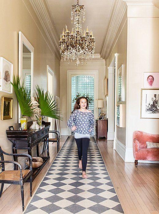 Sara's 12-year-old daughter, Carolina, aka Kiki, races down the central hallway atop a sisal rug painted a black-and-cream diamond pattern.