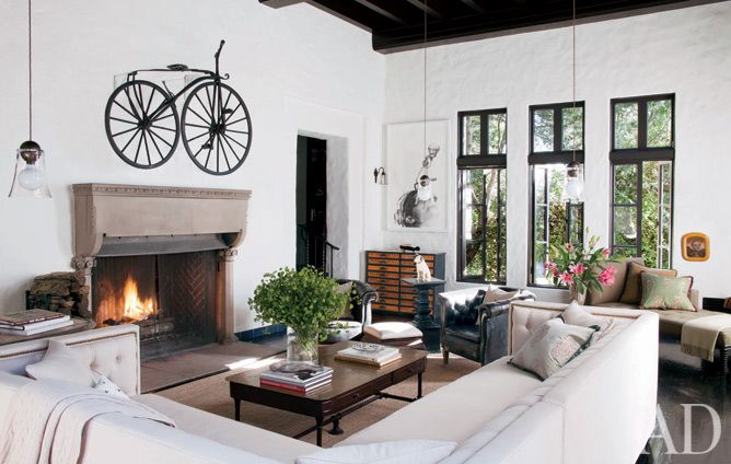 Sheryl Crow's home featured in Architectural Digest.  Love the bicycle over the fireplace and how she used pendants over the side tables.  Very clever.