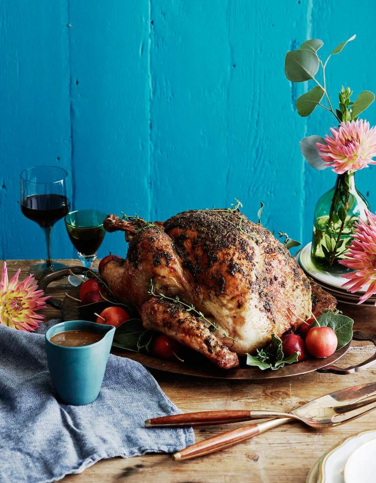 A deliciously moist Herb Roasted Turkey that's surprising easy to make and will be the shining star of your Thanksgiving table!