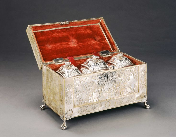 *CARVED MOTHER-OF-PEARL TEA CADDY A rare mid 18th century silver mounted mother-of-pearl casket, finely carved throughout with flowers and leaves, with pierced silver carrying handle
