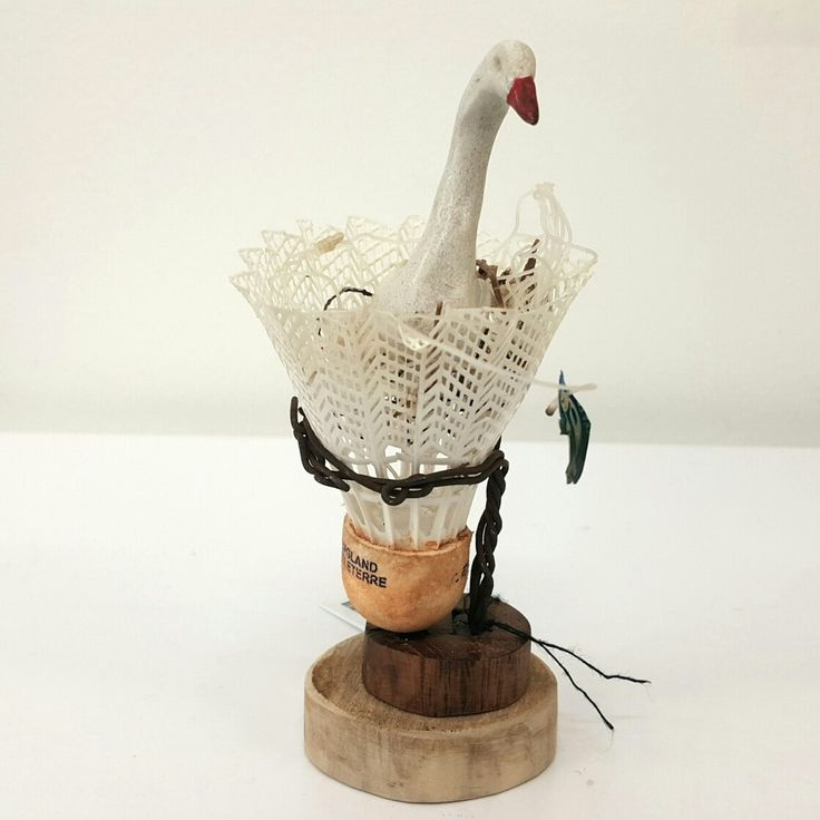 Susie Marwick  Bird in a shuttlecock nest