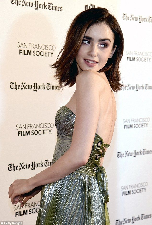 Enviable frame: The bandeau number bared her sculpted back and cinched in her tiny midriff...