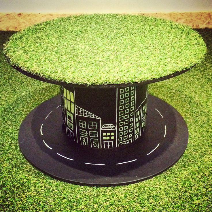 Upcycled cable reel with fake grass and blackboard paint